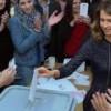الأسد وزوجته يصوتان معا للمرة الأولى